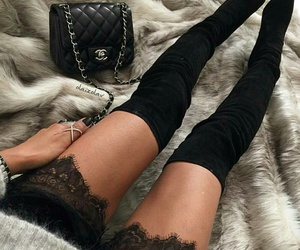 black purse, grey sweater, and lace shorts image