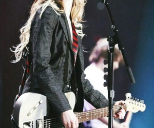 Avril Lavigne and guitar image