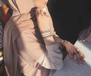 henna, hijab, and tatoo image