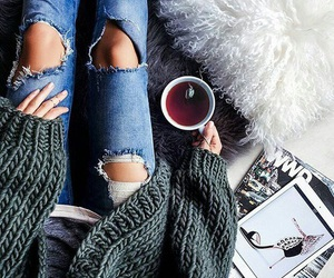 jeans, tea, and sweater image