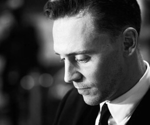 black and white and tom hiddleston image