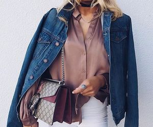 denim jacket, white jeans, and pink stick sweater image