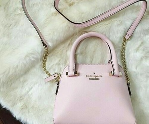 kate spade purse, white faux fur rugs, and light pink purse image