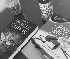 books, candle, and chocolate image