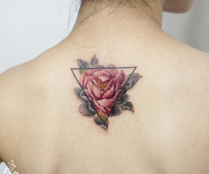 back, triangle, and flower image
