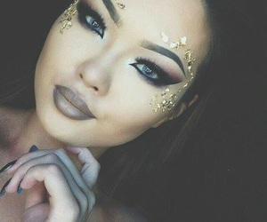blue eyes, smokey eyes, and bronze image