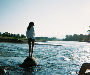 girl, water, and rock image