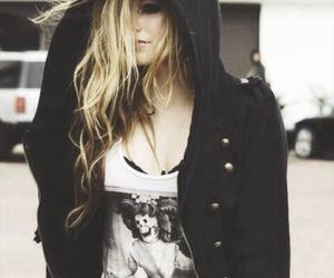 Avril Lavigne and black star image