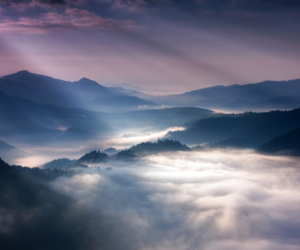 clouds, light, and mountains image