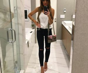 black jeans, high heels, and white top image