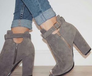 blue jeans, grey ankle booties, and blue ankle jeans image