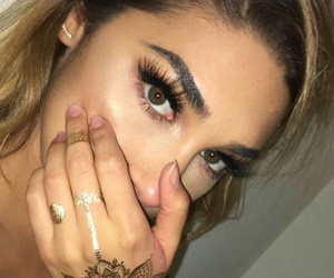 eyebrow, henna, and hairstyle image