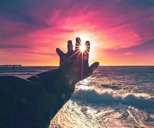 sea, sunset, and hand image