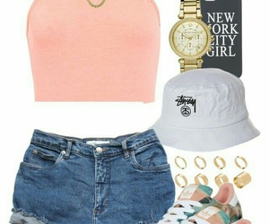 gold chains, gold hoops, and blue denim shorts image
