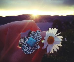 flowers, ring, and sun image