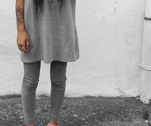 arm tattoos, silver rings, and grey t-shirts image