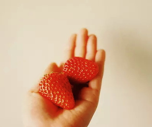 strawberry, hand, and fruit image