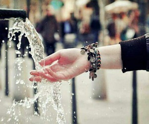 water, bracelets, and hand image