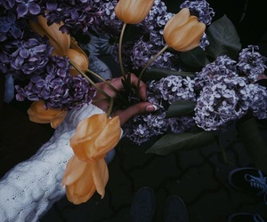 beautiful, hand, and flowers image