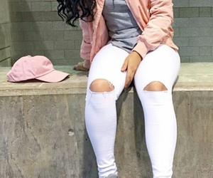 grey sneakers, pink bomber jacket, and white ripped jeans image
