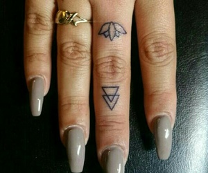 finger tattoo, triangle tattoo, and gold rings image