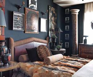 bed, black wall, and fur image