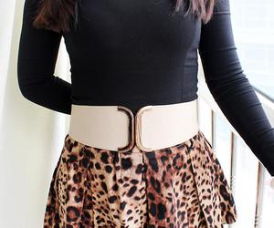 golden bow shape belt and white leather cuff belt image