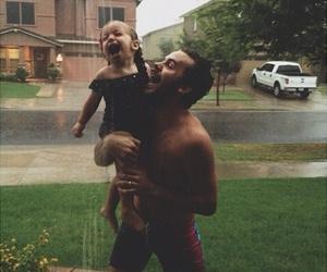 family, baby, and rain image