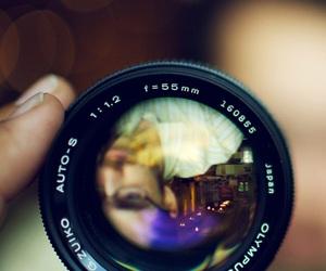 man, reflection, and camera lenses image