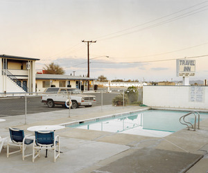 car, motel, and pool image