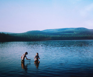 lake, couple, and water image