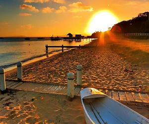 sunset, beach, and boat image