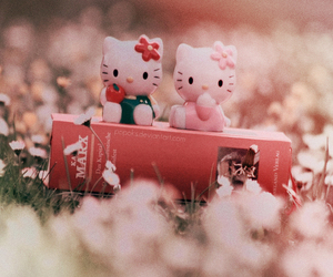 book and hello kitty image