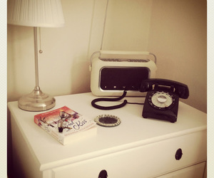 bedside, lamp, and book image