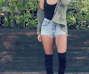 black tank top, light blue denim shorts, and black knee high boots image
