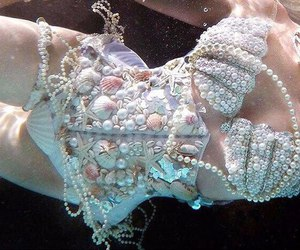 mermaid, pearls, and shell image