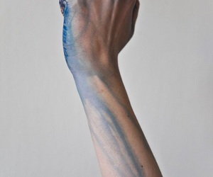 hand and blue image
