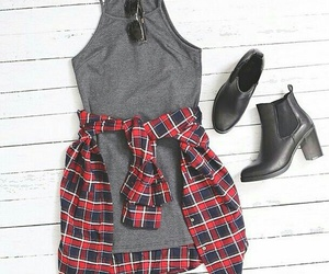 black sunglasses, black ankle booties, and red flannel shirts image