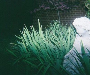 green, dark, and statue image