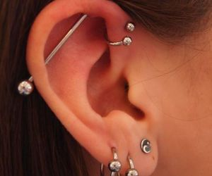 piercing, ear, and industrial image