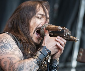 Tattoos, long haired man, and tomi joutsen image