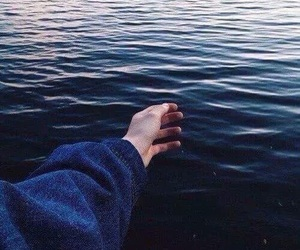 sea, hand, and blue image