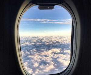 airplane window clouds image