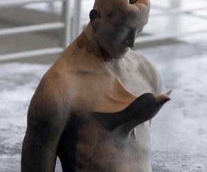 bird, man, and sculpture image