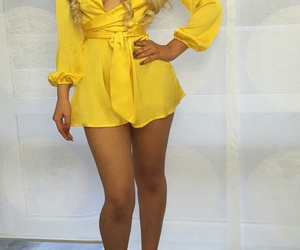 v neck romper, floral pumps, and yellow romper image