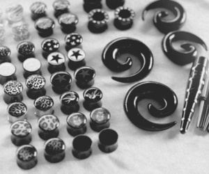 Plugs, black and white, and piercing image