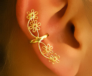 gold earrings, turquoise ear cuff, and floral ear cuff image