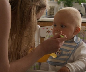 cassie, skins, and feeding a baby image