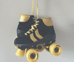 black, gold, and skates image