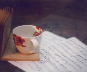 book, cup, and music image